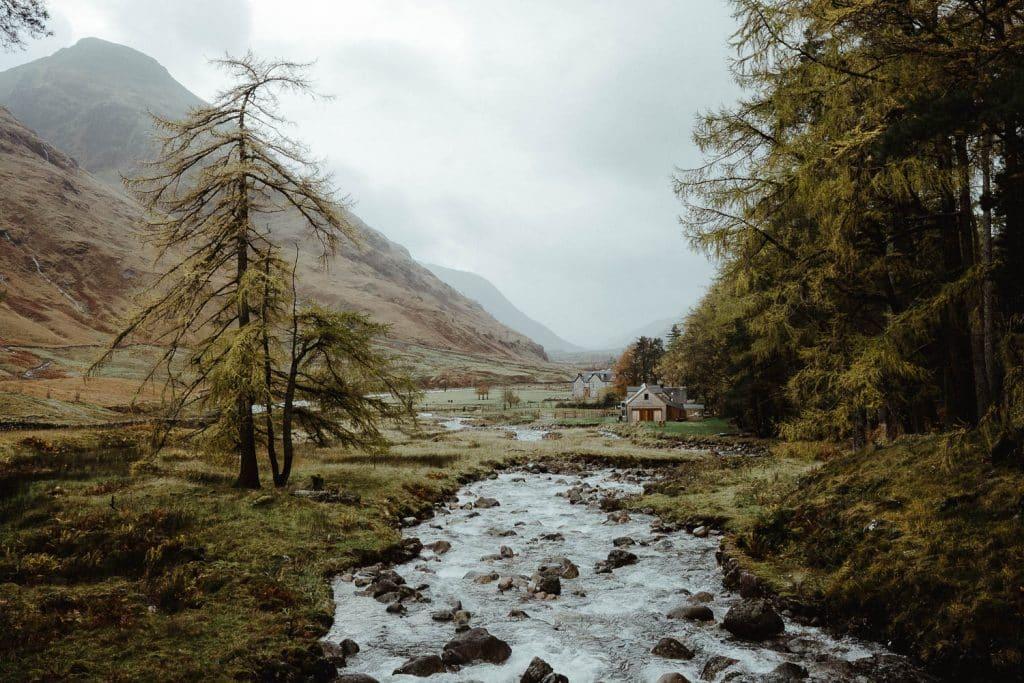 River running through Glen Etive with cottage